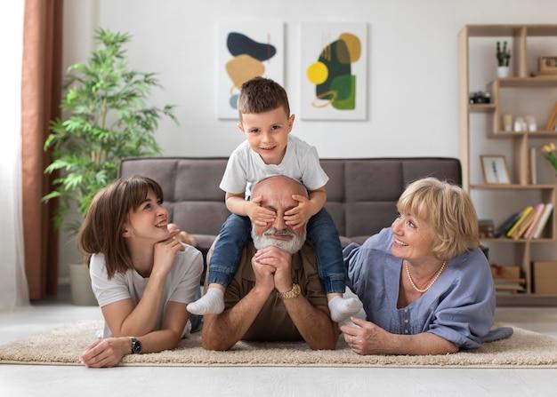 Full shot happy family on floor
