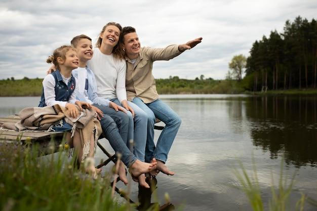 Full shot happy family outdoors
