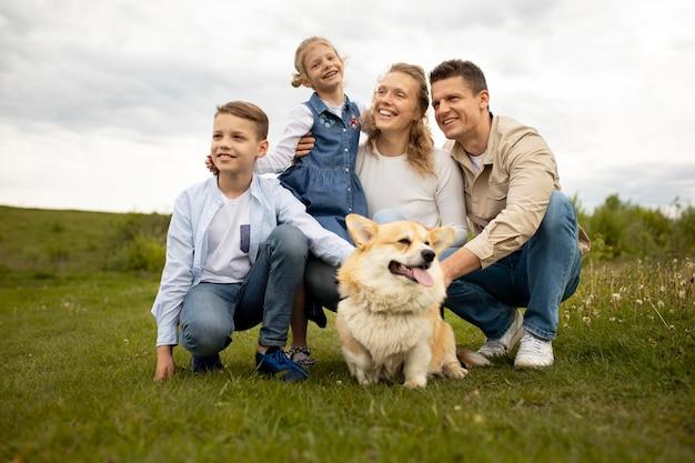 Full shot happy family with dog