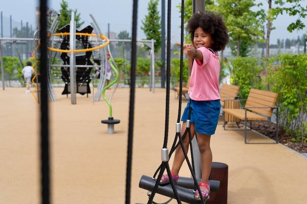 Full shot happy girl in park