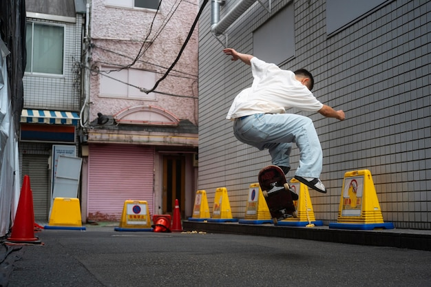 Full shot japanese man doing tricks on skateboard