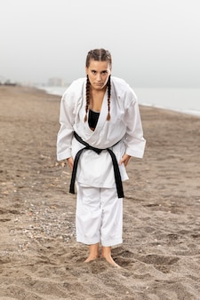 Full shot karate girl in martial arts costume
