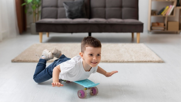 Full shot kid playing with skateboard