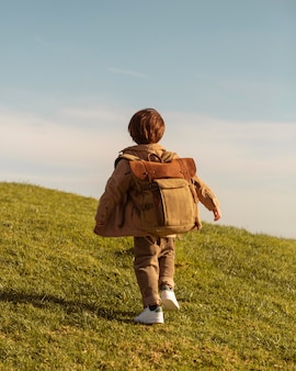 Full shot kid with backpack