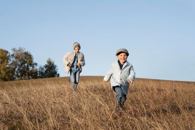 Full shot kids running on field