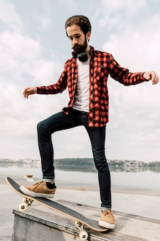 Full shot of man balancing on skateboard