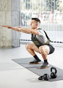 Full shot man doing squats