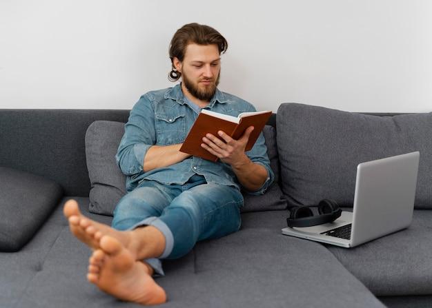 Full shot man reading book