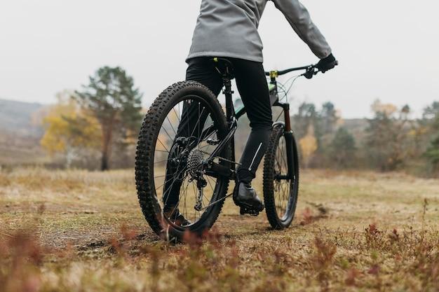 Full shot of man riding a bike