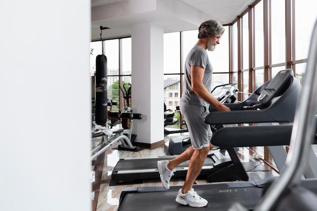 Full shot man on treadmill