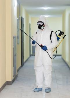 Full shot man wearing gas mask