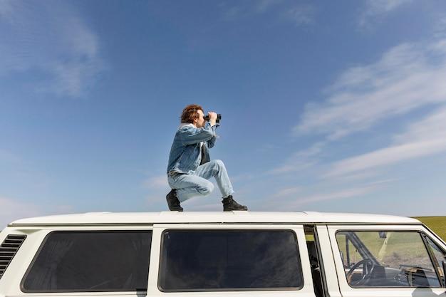 Full shot man with binoculars