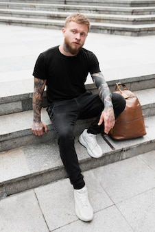 Full shot man with tattoos