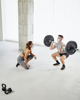 Full shot man and woman working out