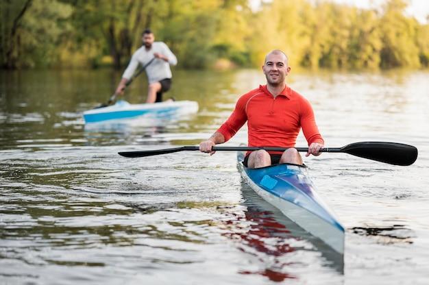 Full shot men with oars