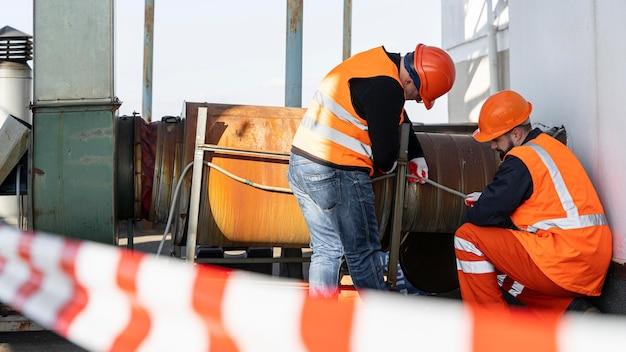 Full shot men working together
