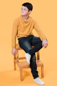 Full shot of modern boy posing