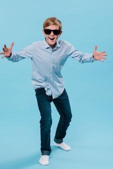 Full shot of modern boy with sunglasses