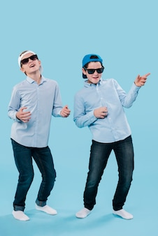 Full shot of modern boys having fun