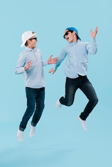 Full shot of modern boys jumping