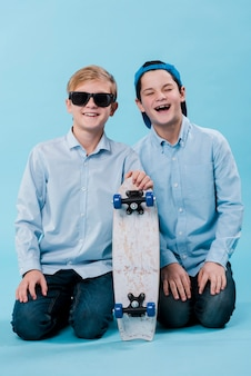 Full shot of modern boys with skateboard
