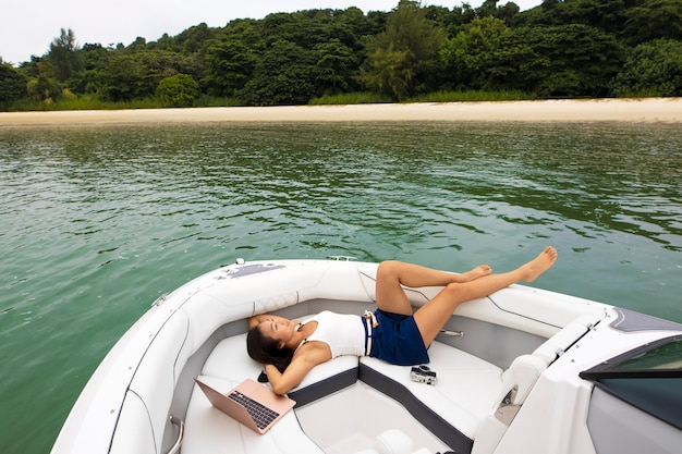 Full shot nomad woman relaxing on boat
