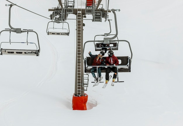 Full shot people on chairlift