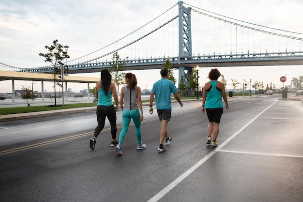 Full shot people running in city
