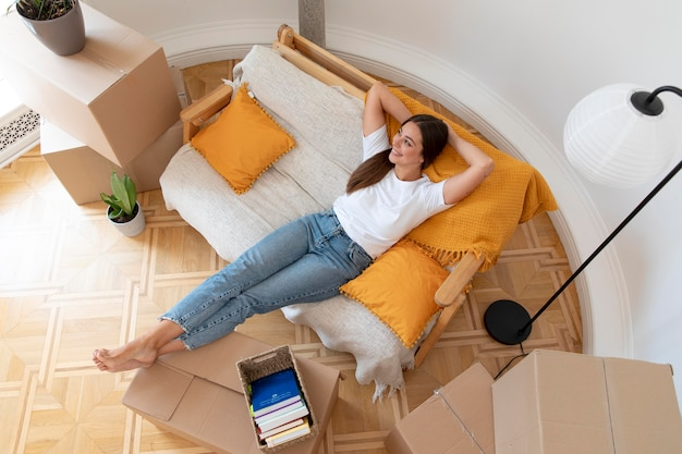 Full shot relaxed woman laying on couch