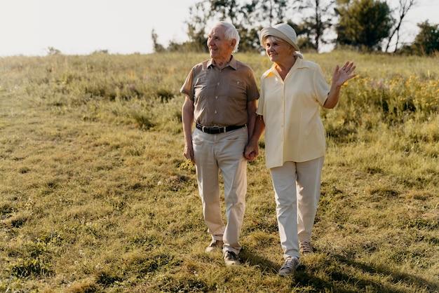 Full shot senior couple outdoors