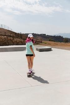 Full shot skater wearing cap