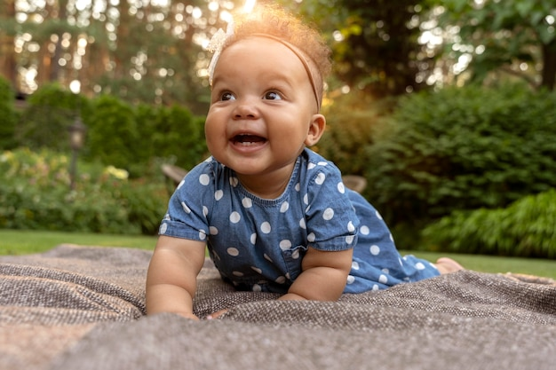 Full shot smiley baby in nature