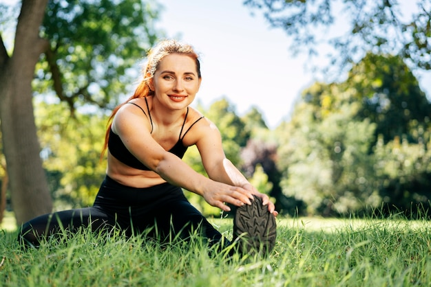 Full shot smiley fit woman exercising