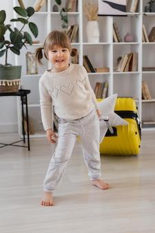 Full shot smiley girl indoors
