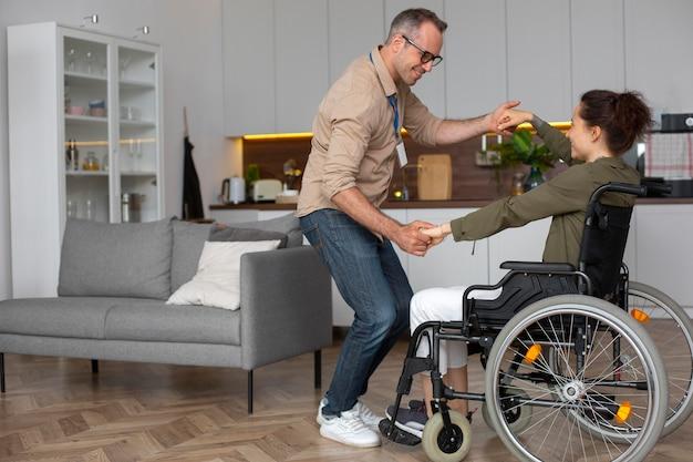 Full shot smiley woman dancing in wheelchair