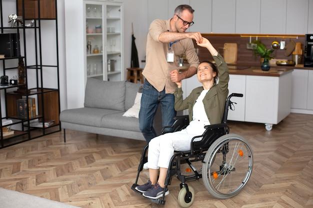 Full shot smiley woman in wheelchair