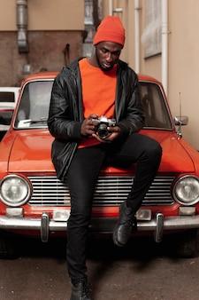 Full shot of stylish photographer