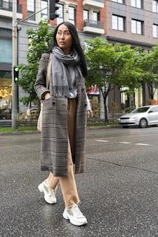 Full shot stylish woman walking