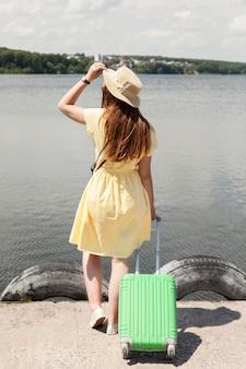 Full shot tourist near lake