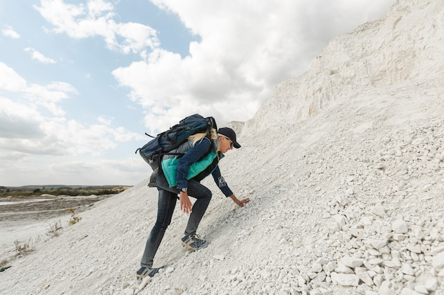 Full shot woman climbing up the hill