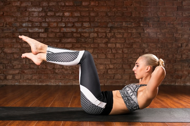 Full shot woman complex yoga exercise