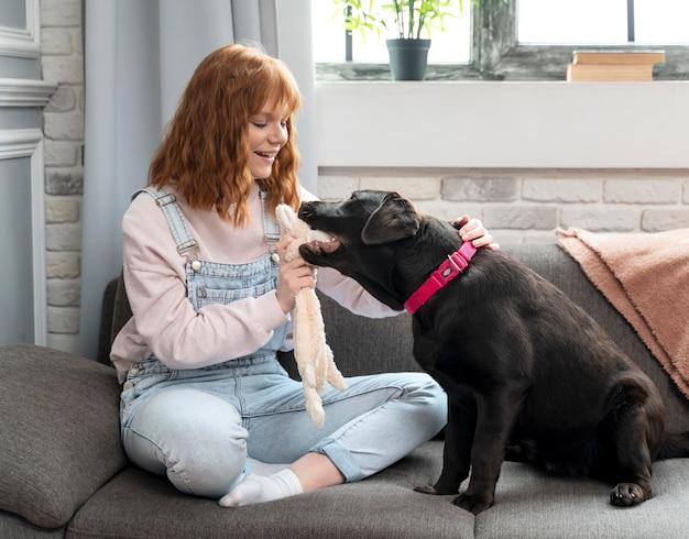Full shot woman and cute dog