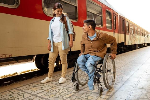 Full shot woman and disabled man