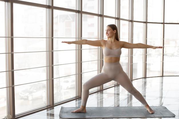 Full shot woman doing exercises