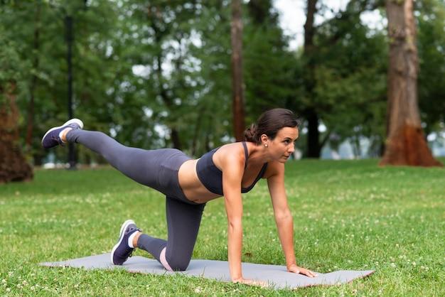 Full shot woman doing sport