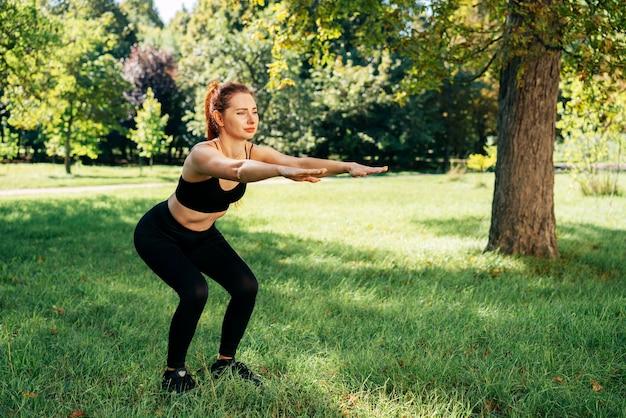 Full shot woman doing squats