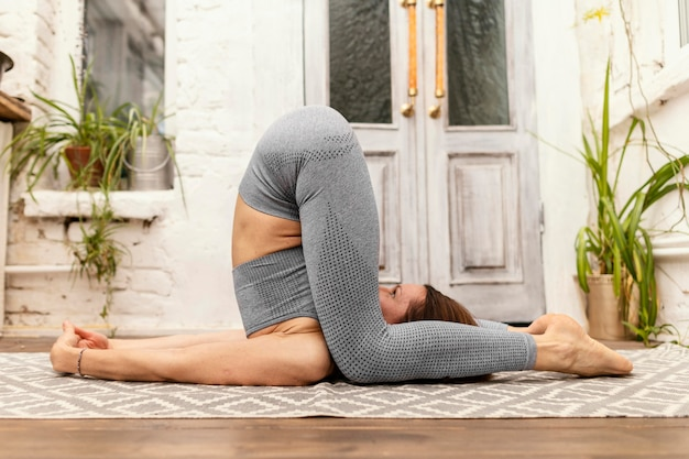 Full shot woman doing stretching exercise