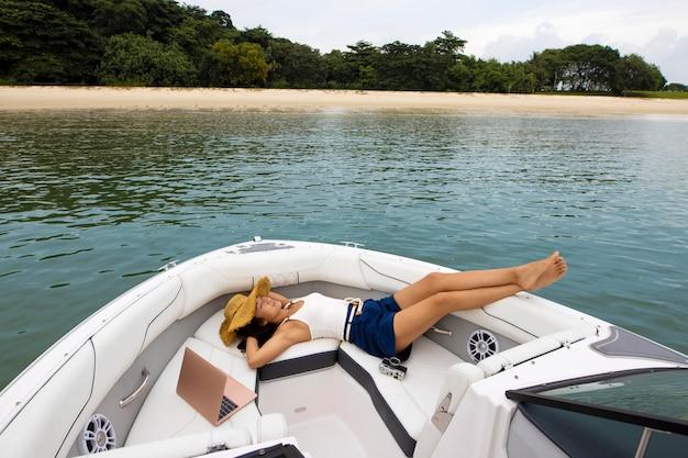 Full shot woman laying on boat
