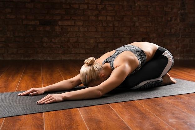 Full shot woman laying down pose