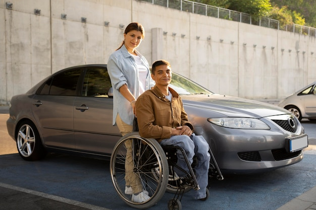 Full shot woman and man in wheelchair